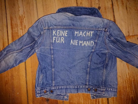 "Denim jacket with homemade lettering ""No Power for Noone"""